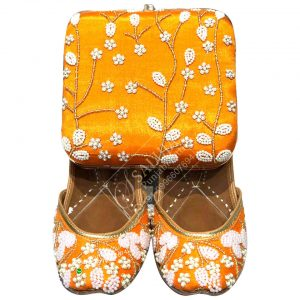 Orange Punjabi Jutti With Matching Clutches