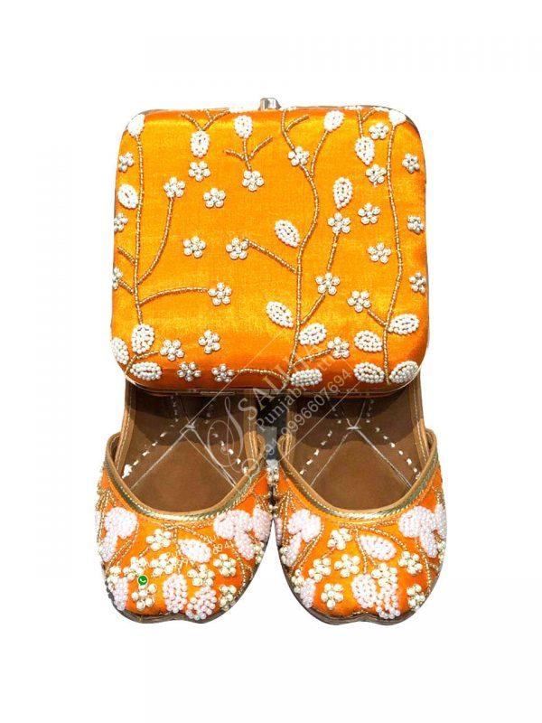 Orange Punjabi Jutti With Matching Clutches